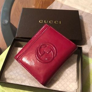 Gucci wallet lot of room for cards, coins, bills.